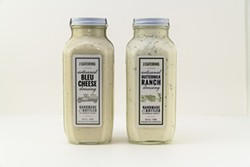 PHOTO BY ZACH LATHOURIS - J Catering bleu cheese and buttermilk ranch dressings.