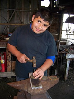 COURTESY OF ERIC AND VIVIANA HOLLENBECK - Jose Pacheco working on a Blue Ox school project in 2013.