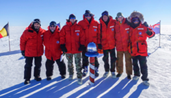 Parts Unknown crew at the South Pole. Ferrell is in the center with Bourdain to his left. Feb. 2, 2017. Photo courtesy Josh Ferrell.