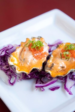 AMY KUMLER - Grilled oysters with cilantro cream and tobiko.