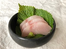 PHOTO BY JENNIFER FUMIKO CAHILL - Mahi mahi sashimi on a shiso leaf.