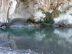 PHOTO BY MEG WALL-WILD - Jagged geology is reflected on the cool water of the Van Duzen River.