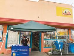 SUBMITTED - Ariel Fishkin, Visión y Compromiso community promotor, tabling in front of El Buen Gusto Market in Eureka..