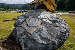 PHOTO BY MARK LARSON - The large stone monument in memory of Madison Grant, after the plaque had been removed, awaited its move to a flatbed trailer on June 14.