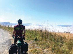 PHOTO BY HOLLIE ERNEST - A cycling break on Bald Mountain Road with a view of the fog below.