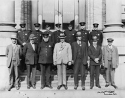 PHOTO COURTESY OF THE HUMBOLDT COUNTY HISTORICAL SOCIETY - Eureka Police Department employees — including Chief George Littlefield, first row, third from right — pose in front of Eureka City Hall.