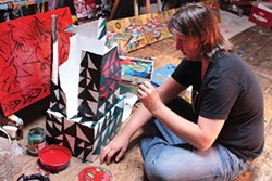 PHOTO BY MONICA TOPPING - Gus clark works in his native habitat during north coast open studios last year.