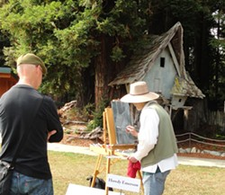 SUBMITTED - Howdy Emerson of Trinidad being watched as he paints during the 2014 Art in the Garden. He will be on hand again this year.