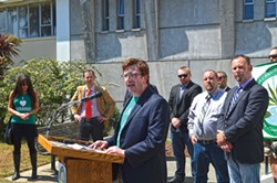 PHOTO BY GRANT SCOTT-GOFORTH. - Luke Bruner speaks at CCVH's June 30 unveiling of its ordinance.