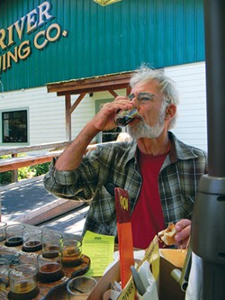 """CARRIE PEYTON DAHLBERG - John Etter works through a """"brewer's flight"""" of beer samples during a Humboldt Beer Tours excursion."""