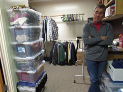 LINDA STANSBERRY - Roger Golec stands in front of HCOE's resource closet.