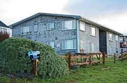 "PHOTO BY TED PEASE - Mike Reinman, manager of Redwood Coast Vacation Rentals, owns Trinidad's only ""apartment building,"" a four-plex next to the Eatery. The City Council recently clarified the VDU ordinance to limit properties to only one short-term rental per parcel."