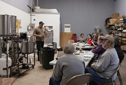 PHOTO BY CARRIE PEYTON DAHLBERG. - Josh Reed offers beer-making tips during a free class on National Learn to Homebrew Day.