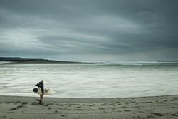 WINNING PHOTO: Sean Jansen took this quintessentially Humboldt picture of someone on the beach eyeing a dark, ominous sky with surfboard and fishing pole in hand. It was voted our staff favorite.