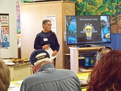 Affordable Homeless Housing Alternatives President Nezzie Wade presents information about a sanctuary camp proposal on March 7. Photo by Linda Stansberry