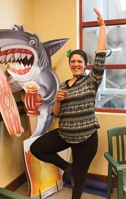 "PHOTO BY CARRIE PEYTON DAHLBERG - Angelina Henderson enjoys her beer with a tree pose after leading the first ""Yoga at the Brewery"" class at Lost Coast Brewery."