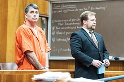 PHOTO BY MARK MCKENNA - Gary Lee Bullock (above left) stands next to his attorney, Kaleb Cockrum, during his arraignment on charges that he murdered St. Bernard's Catholic Church pastor Eric Freed on New Year's Day of 2014. Bullock, who is currently standing trial, has since entered dual pleas of not guilty and not guilty by reason of insanity in the case.