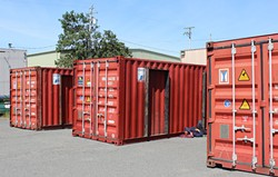 PHOTO BY THADEUS GREENSON - Shipping containers sit ready to be converted into living quarters in the vacant lot owned by Mercer Fraser Co. at the corner of Third and Commercial streets in Eureka.