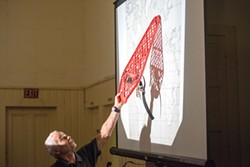 PHOTO BY MARK MCKENNA - Stepp tracing the theoretical journeys of Viking ships.