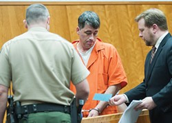 Gary Lee Bullock, pictured here at his arraignment with his attorney Kaleb Cockrum (right), was sentenced to serve life in prison without the possibility of parole for the Jan. 1, 2014 murder of St. Bernard pastor Eric Freed. Photo by Mark McKenna
