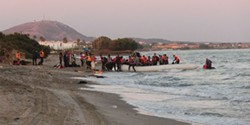 PHOTO BY CHRISTOPHER JAHN/INTERNATIONAL FEDERATION OF RED CROSS AND RED CRESCENT SOCIETIES - By the hundreds of thousands, refugees have braved the sea passage from Syria and Turkey to arrive on Greece's shores.