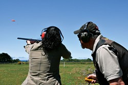 AMY BARNES - Taking aim with Ron Ruchong.