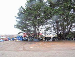 PHOTO BY LINDA STANSBERRY - Belongings wait for owners at Koster and Washington.