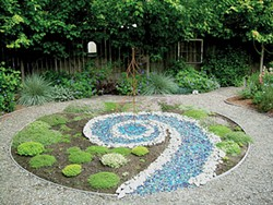 PHOTO BY DONNA WILDEARTH - A stone spiral with a sculptural centerpiece in a Fortuna garden.