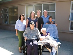 PHOTO COURTESY OF CATHERINE PUGEL - John and Ellie Catudal, pictured here with family members, are uncertain where they will go if forced to leave Eureka Rehabilitation and Wellness, which is slated for closure.