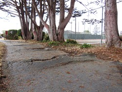 LINDA STANSBERRY - Cracked sidewalks and unused tennis courts at Highland Park.