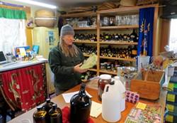 PHOTO BY AMY BARNES - Herbal activist and healer Greta de la Montagne describes the medicinal properties of usnea.