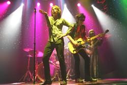 "Chris Legrand (""Mick""), John Wade (""Billl Wyman"") and Trey Garitty (""Keith Richards"")"