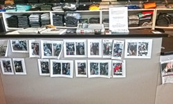 PHOTO BY LINDA STANSBERRY - The counter at Irv's Big and Tall is decorated with stills from its security cameras.