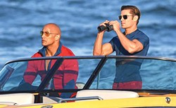 BAYWATCH - Dwayne Johnson and Zac Efron watching people eat carbs from a safe distance.