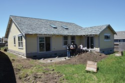PHOTO BY AMY BARNES - The house on Maplewood Drive is nearly complete. Building Trades students have helped build it from the ground up and students in Dave Enos' Architectural Design class drew the plans.
