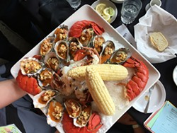 PHOTO BY JENNIFER FUMIKO CAHILL - A luxe lobster and oyster spread from Five Eleven.