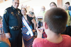 PHOTO BY MARK MCKENNA - Miss Independence Day Queen Meghan McCracken and Mills pose while Quentin Glass, 8, takes a photo on McCracken's phone.