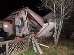 COURTESY OF HUMBOLDT BAY FIRE - The force of this butane hash lab explosion outside of Eureka knocked the house off its foundation and lifted the roof off the walls.