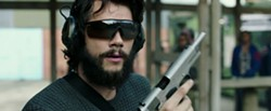 AMERICAN ASSASSIN - The gun says trained killer but the shades say Mayor of Flavortown.