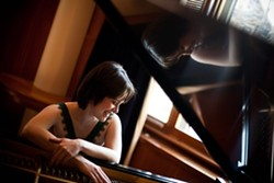 51a6d2ff_smiling-profile-at-piano-color-june2011-1mg.jpg