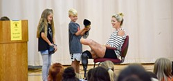 PHOTO BY LINDA STANSBERRY - Locatelli's niece and nephew help remove her prosthetic.