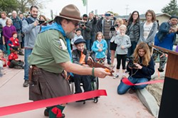 PHOTO BY MARK MCKENNA - Humboldt Hot Sauce owner and Redwood Rangers leader Daniel Bixler helps Ernesto Cappuccio cut the opening day ribbon.