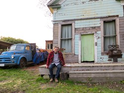 PHOTO BY AMY BARNES - Eric Hollenbeck sits at the Blue Ox Millworks.