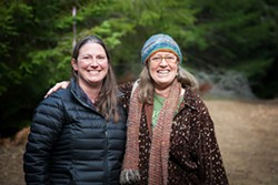 PHOTO BY AMY KUMLER - Sanctuary Forest Executive Director April Newlander (left) with Tasha McKee, the nonprofit's water program director.