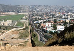 CREATIVE COMMONS - Border fence between San Diego's border patrol offices in California (left) and Tijuana, Mexico (right)