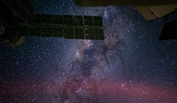 PHOTO BY NASA/REID WISEMAN - The Milky Way looks thick with stars in this photo taken from the International Space Station. In reality, stars are spread far apart — about one per 300 cubic light years.