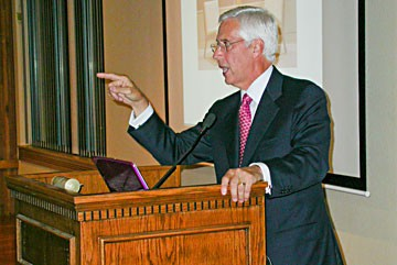 Umpqua Holdings Corporation President and CEO Ray Davis speaks at the Wharfinger building last week. Photo by Ryan Burns