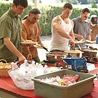 Upward Bound No More Vets line up for grub at a luncheon for new students held last week. Photo by Yulia Weeks.