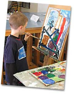 Young artists work on a collaborative project at the Studio School.