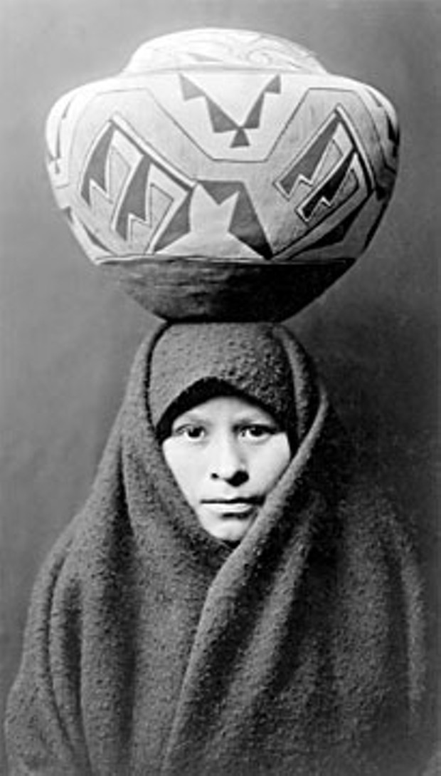 Young Zuni woman with jar.
